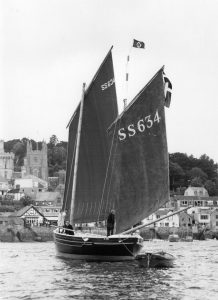 At the start of the Tall Ships Race, Fowey, 1979. Maureen Tatlow at the mizzen. Robbie Tatlow