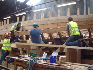 Re-planking. Many planks had to be steamed and speed and teamwork were essential