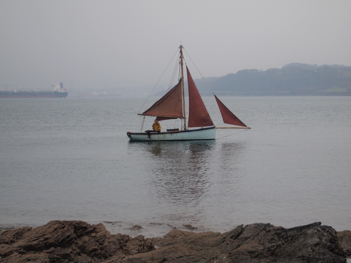A Falmouth oyster dredger working under sail